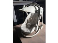 Mamas & Papas Starlite swinging baby chair. Keeps baby happy and content with lights and music.