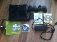 Xbox 360 250gb hard drive and 2 controllers and 4 games