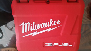Just Like New Milwaukee 12V Charger and Case  All like new  Batt