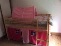 Child's high bed with pink tent and tunnel