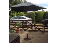 Large wooden garden parasol and iron base