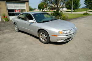 2001 Olds Aurora , 123000 km's , $1500.00 or trade on 4 wheeler