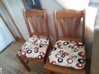 PAIR OF SOLID PINE DINING CHAIRS WITH SEAT CUSHIONS..