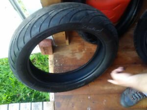 2 Michelin Road Pilot & 1 Metzler Tire