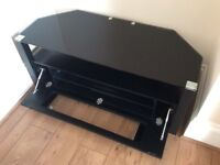 Immaculate black glass TV cabinet