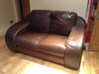 Free 2 seater brown leather sofa requires collection