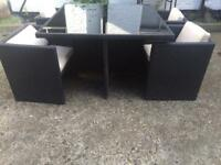 Glass top rattan table with 4 cushioned chairs