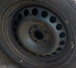 """Four 16"""" metal rims in excellent condition"""