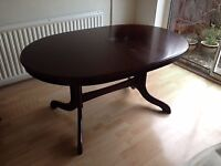 Gorgeous Solid Extending Mahogany table seats 8-10 people, good used condition poss for a project?