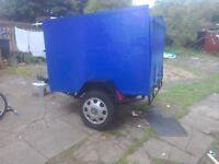 A car trailer 5feet X 4feet x3feet high leaf springs lights
