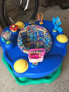 Evenflo Exersaucer with extra toys