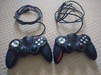 Two Saitek USB Video Game Controllers