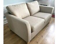 2 seater Sofa bed. Cream Fabric.