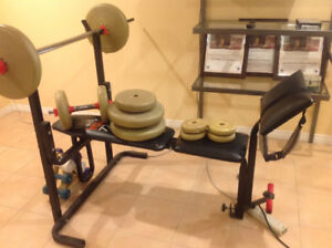 Press bench with set of dumbells