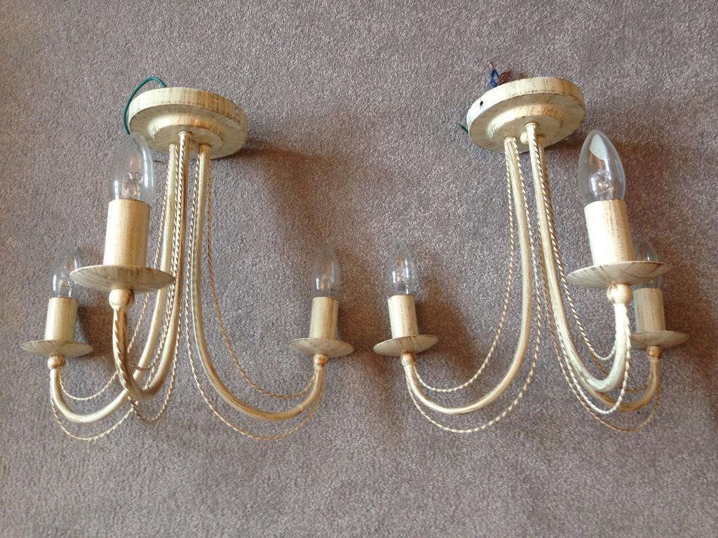 Two cream 3 light ceiling lights