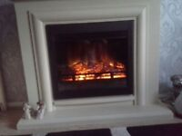 Electric Fire with surround remote controlled Mint condition please see pics
