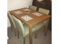 Oak Table with 4 faux leather cream chairs
