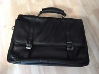BRIEFCASE. Black leather in VGC. Mens traditional style. Carrying strap. Numerous pockets.