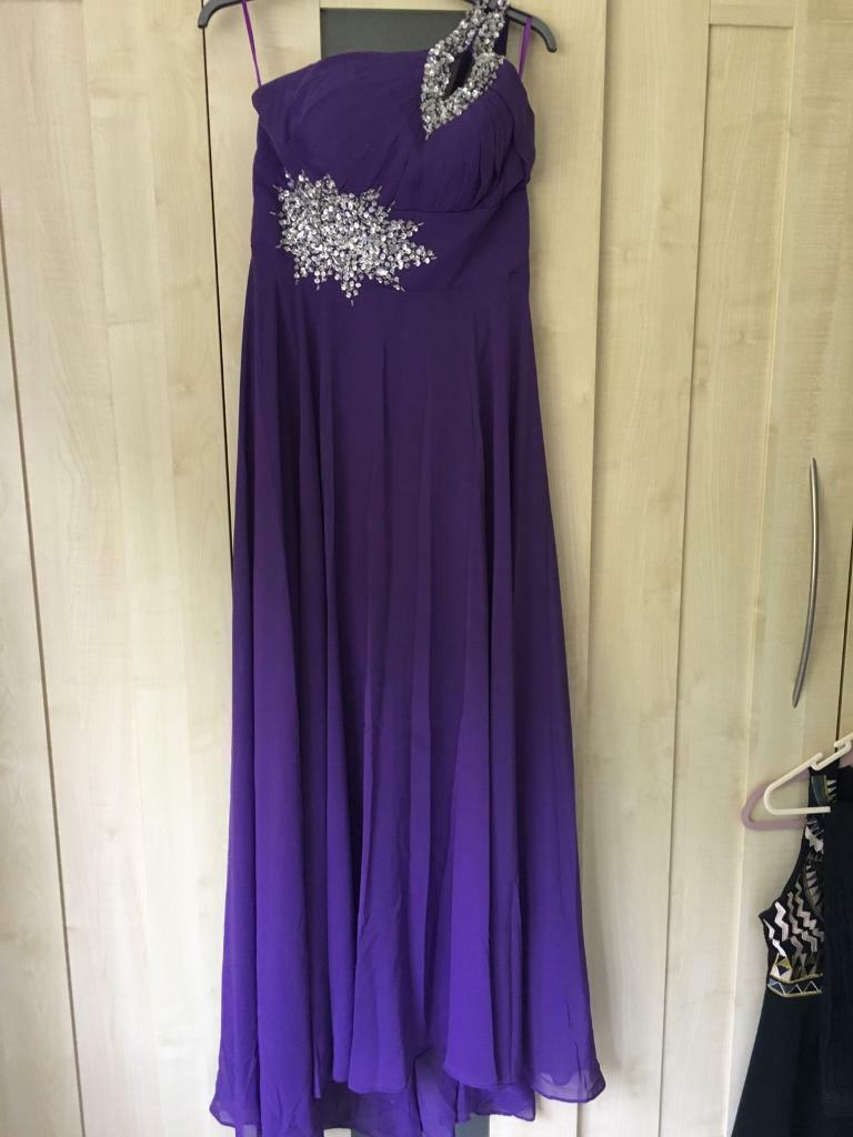 Purple dress with diamontesin Hawkinge, KentGumtree - Floor length Purple dress with diamontes. Only worn once for a wedding. The back is done up in a corset fashion. Size M