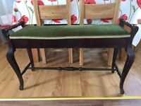 Very old duet piano stool with space for music under the seat. It's seen service!