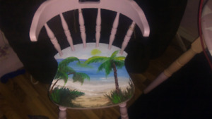 Hand painted chair of a beach with palm trees