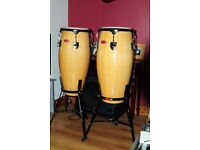 A set of mint condition, used Stagg 10 and 11 inch Bongo's with stands for sale