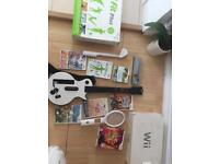 Nintendo Wii Fit Plus With Games And Guitar Hero (Everything you see in the photos