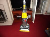 yellow and grey dyson in good working order