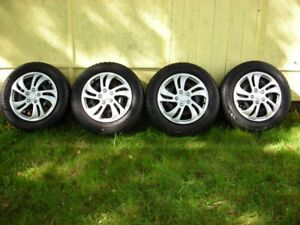 4 studded Winter Claw tires on rims 195/65 R15