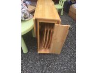 Wooden Drop leaf table with 3 enclosed chairs