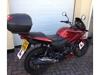 Honda 125 CBF. Immaculate condition in Red with top box.