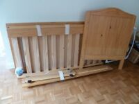 Pine cot bed with under storage drawer and converts easily in to a junior bed