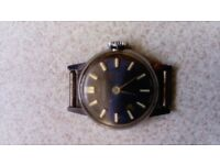 Ingersoll vintage watch blue face has slight blemish on the face no strap very old viewing welcome