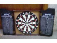 Dartboard in wooden casing with scoreboards