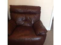 DFS Brown leather arm chair