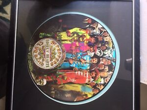 The Beatles album (2) ( one in frame one in plastic case )