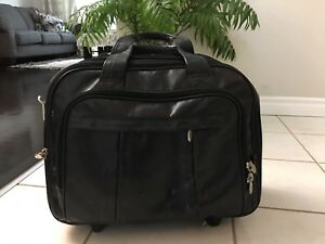 Wheeled Black leather laptop bag with 4 pockets.