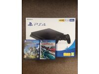 BRAND NEW, SEALED PS4 500gb slim, with two games.