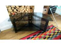 Glass & black metal tv unit offers welcome
