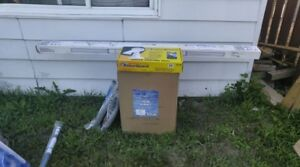21 foot solar blanket with reel, still in the box brand new