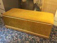 Bedroom blanket chest/padded seat. Gold dralon, fringe trim.