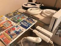 Nintendo Wii with 2 controllers, 6 games and accessories