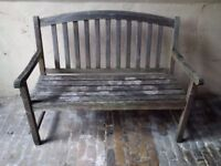 beautifully weathered wooden garden bench