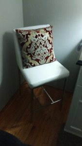 6 white leather chairs