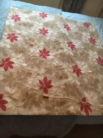 Beige and red roman blind