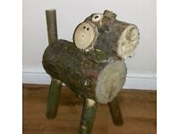Large wooden dog garden ornament
