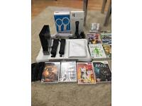Nintendo Wii (Black) hardly used + games + accessories