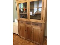 Antique pine dresser. Lower cupboard with drawers, upper has shelves with glass doors.