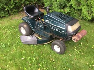 "12-hp. 42"" cut. Mtd. Riding lawnmower."