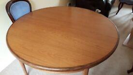 G Plan Teak Circular Extending Dining Table.